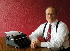a picture of author Michael Eckers with a typewriter